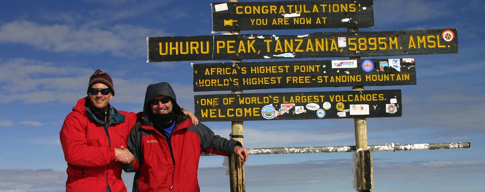 George Fisher and Alan Barkley atop Uhuru Peak, Kilimanjaro; February 2004